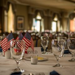Table setting with little flags in the Emerald Grande ballroom