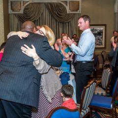 Derrick Moore hugging Lisa Deslauriers