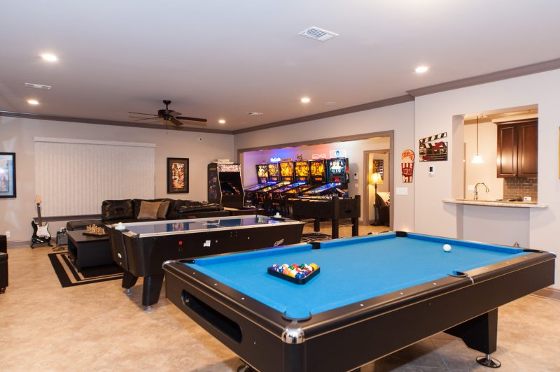downstairs game room with pool table and pinball machines