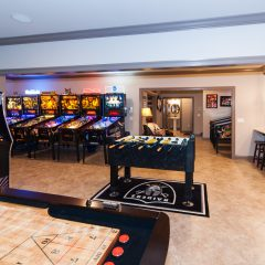 Game room with pinball machines and foosball table