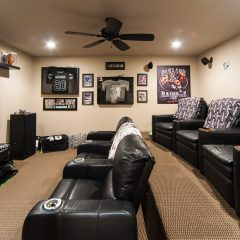 Basement social area with sofas and large TV
