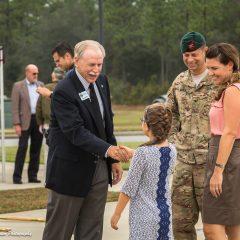 Young girl shaking hands with elderly gentlemen