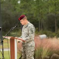 young soldier giving speech at ceremony