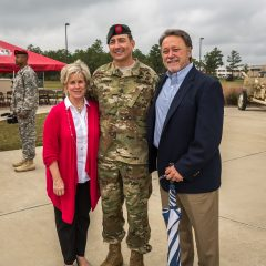 Randy and Debbie Wise posing for photos with a soldier