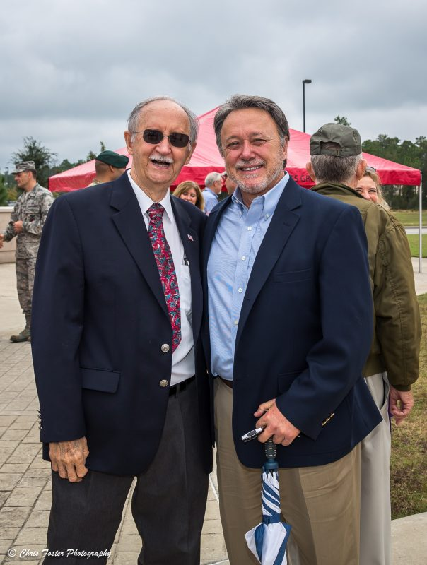 Randy Wise standing with an elderly man