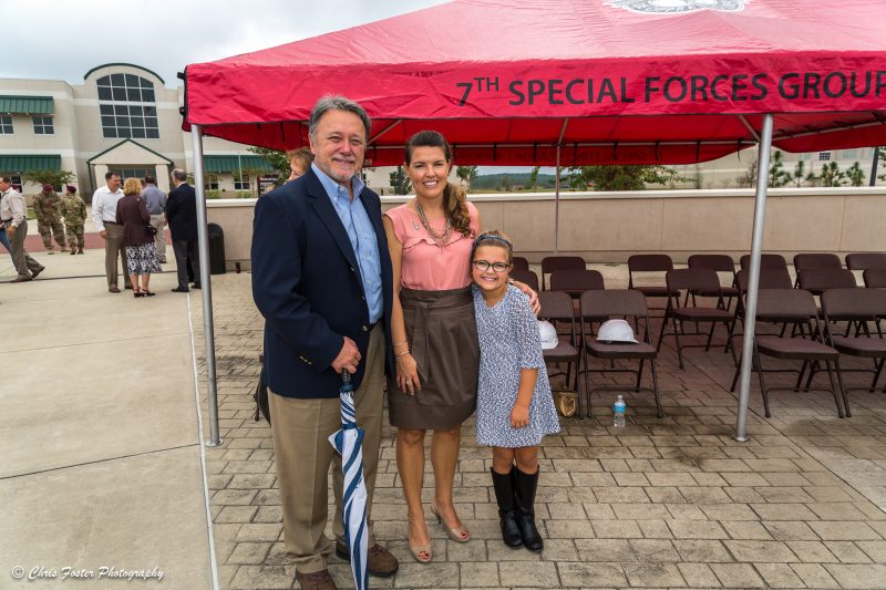 Randy Wise posing with the young girl and her mother