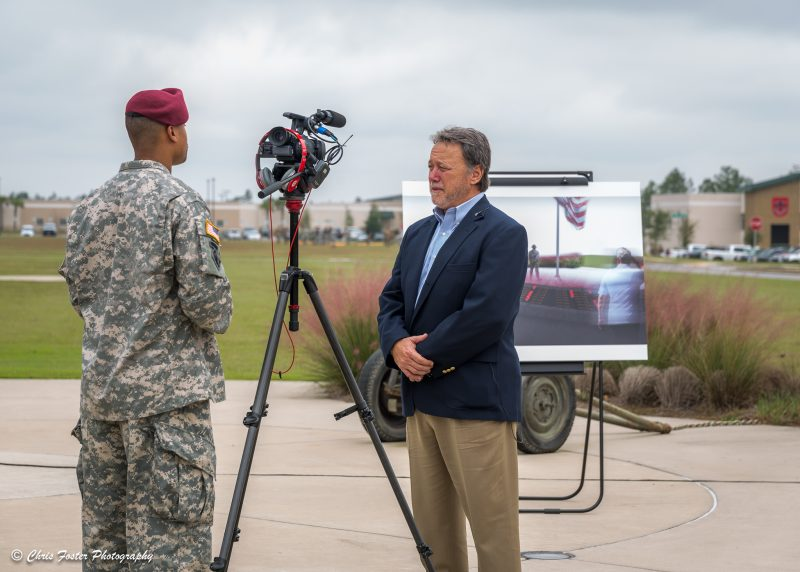 Randy being interviewed by a soldier with a camera