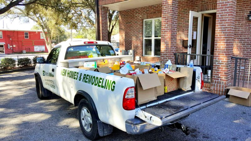 Randy Wise New homes truck delivering donations and supplies