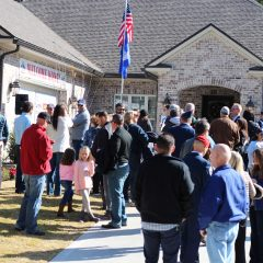 People gathering outside the new Nelson home
