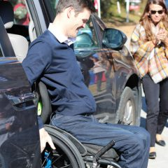 Captain exits the vehicle in a wheelchair