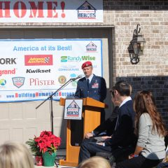 Man wearing uniform speaking at the Nelson Welcome Home event