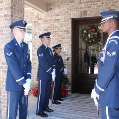 Airmen lining the entrance to the Nelson home