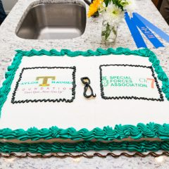 A cake featuring the Taylor Haugen Foundation and The Special Forces Association Chapter 7 logos
