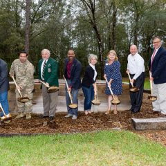 Randy and Debbie Wise along with members of The Special Forces Association Chapter 7, the Taylor Haugen Foundation and United Bank, breaking ground at the new Community Sprit Home site.