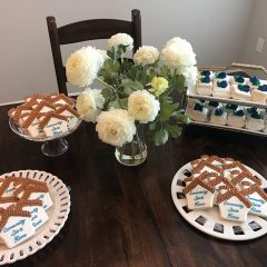 Table with flowers and cookies at the 2019 Community Spirit Home Event