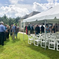 The 2019 Community Spirit Home Event crowd walking around the property conversing