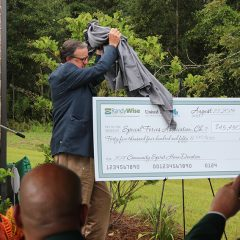 Robert Jones reveals a large check