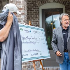 Randy Wise presenting a large check at the 2019 Community Spirit Home Event