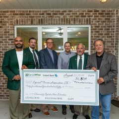 Randy Wise, Amil Alvarez and company presenting a large check the sum of $50,534 for the 2019 Community Spirit Home event