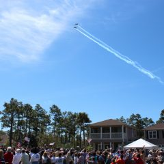 Jets fly overhead at the gathering