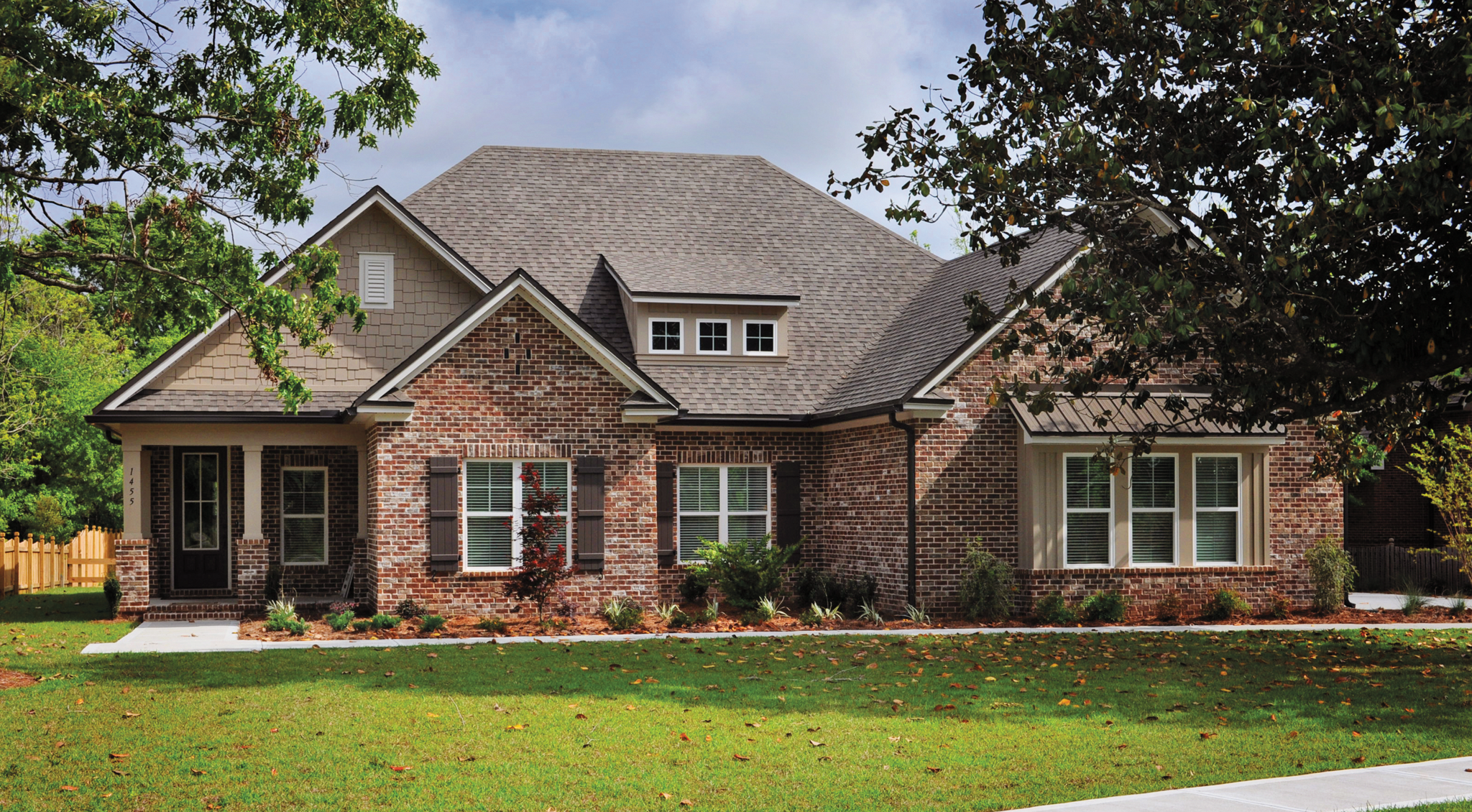 Exterior red brick home in Mill Creek Farms