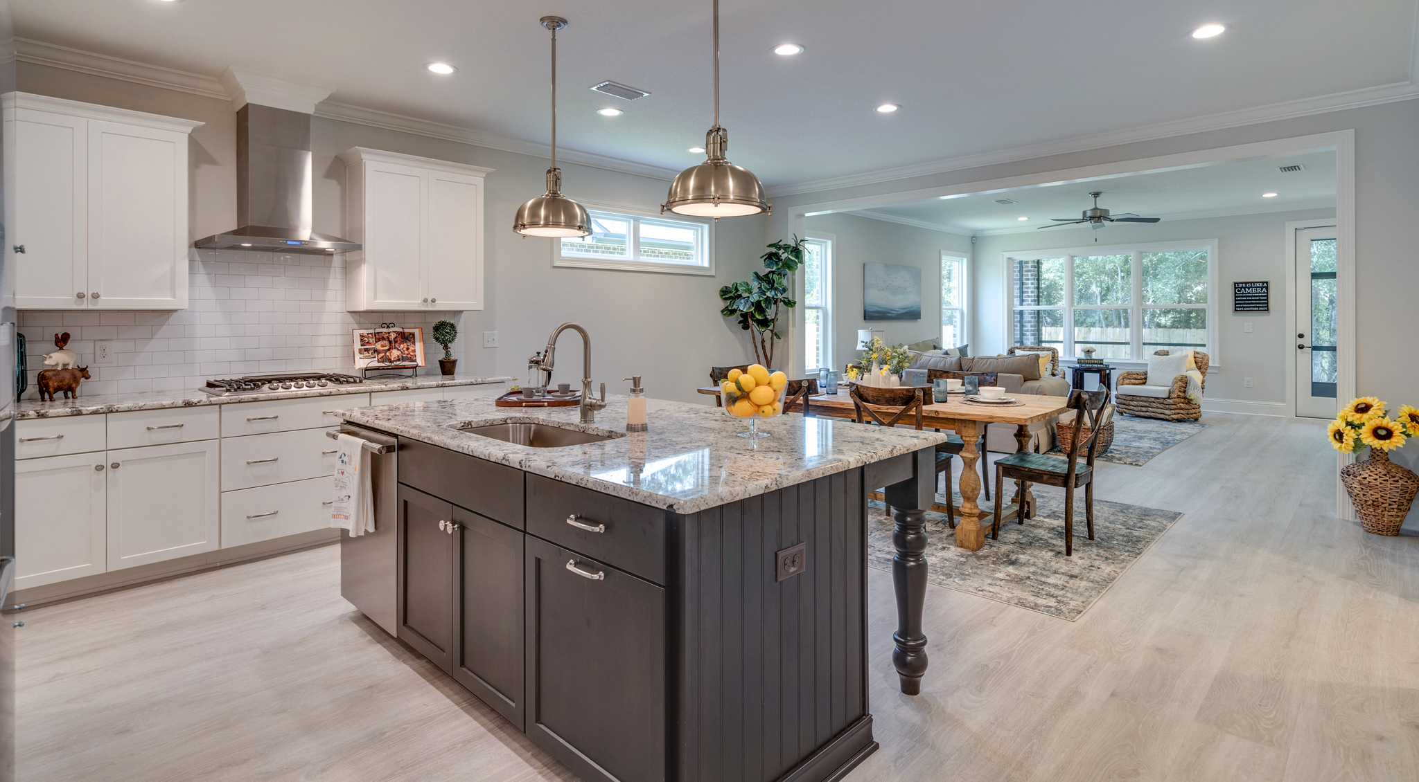 Open living area and kitchen island in Osprey home