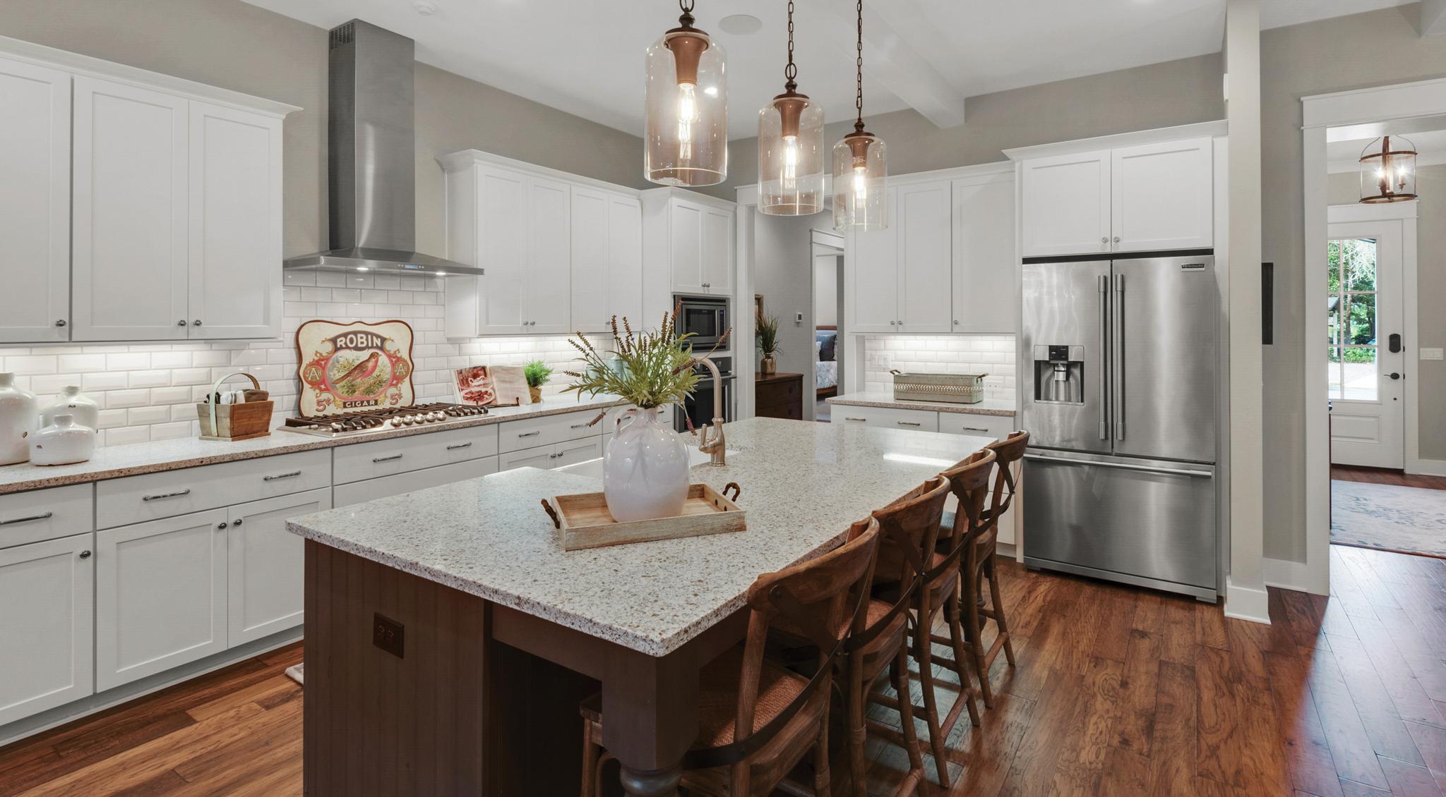 Wood and granite countertops in Water's Edge kitchen