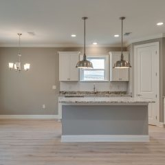 Redfish Kitchen with Island, Subway Tile, Pendant Lighting and Stainless Steel Appliances