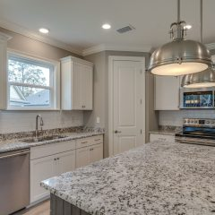 Redfish Kitchen with Island, Pendant Lighting, Subway Tile and Stainless Appliances