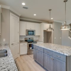 Redfish Kitchen with Island, Stainless Appliances, Subway Tile and Pendant Lighting